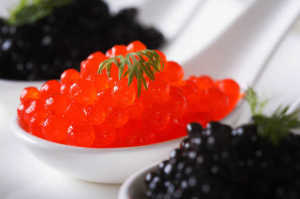delicacy-red-and-black-caviar-fish-macro-in-white-spoons-on-a-plate